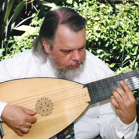 Instructor Gary Digman playing the lute